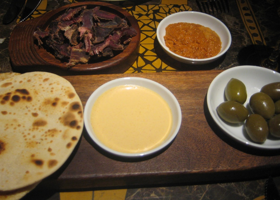 Shraak bread, olives, biltong and cumin dip at Shaka Zulu